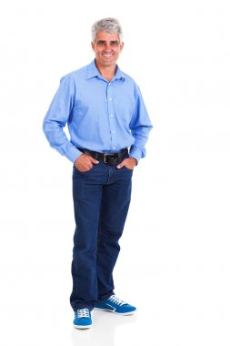 Middle aged man standing on white background