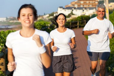 happy active family jogging