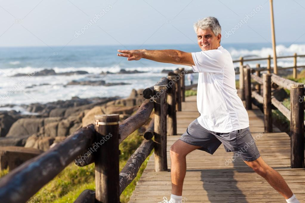 Active Middle Aged Man Doing Morning Workout At The Photo By Michaeljung