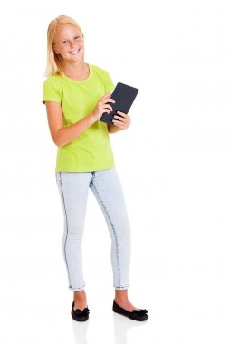 beautiful teen girl holding tablet computer