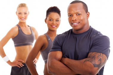 handsome male personal trainer and team