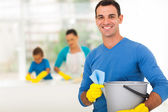 Photo happy family man cleaning home with family