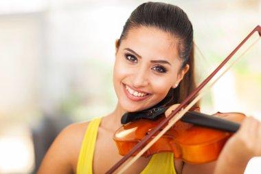 beautiful female musician playing violin