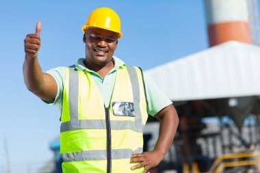 african construction worker giving thumb up