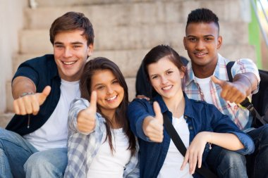 high school students giving thumbs up