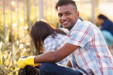 teen volunteers cleaning streets