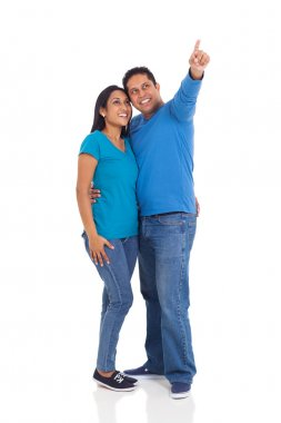 young married indian couple pointing on white background