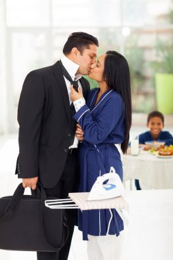 Loving husband kissing wife before going to work stock vector