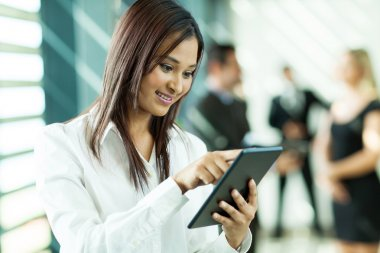 indian white collar worker using tablet computer