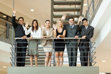 Business people waving at stairway