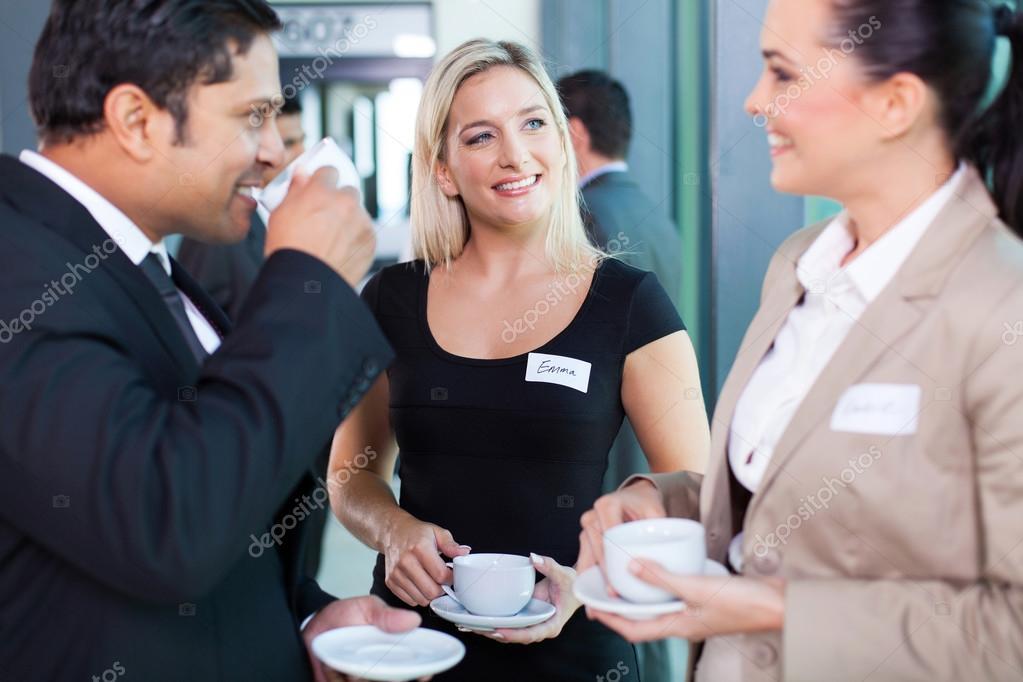 business people having coffee break during seminar