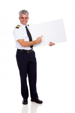 senior airline captain pointing empty board