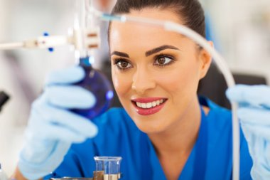 beautiful young scientist working in lab