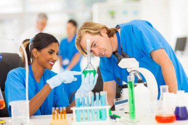 two scientists studying substances in laboratory
