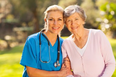 medical nurse and senior patient outdoors