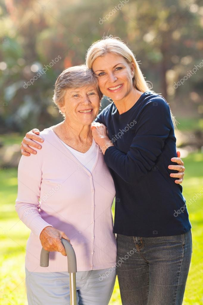 mature woman with her senior mother outdoors