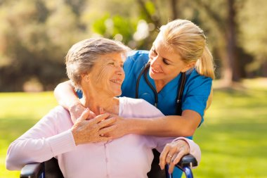 caring nurse with senior patient