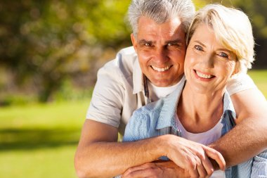Senior man hugging wife
