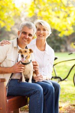 Senior couple and pet dog