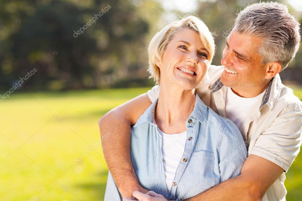 middle aged couple embracing outdoors
