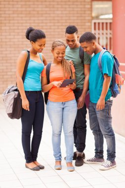 group of african american college students using tablet computer