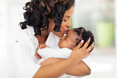 African american woman kissing her baby