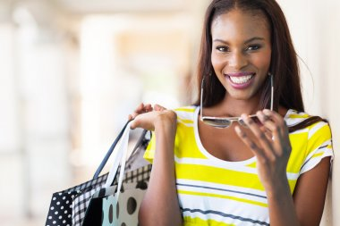 cheerful african american woman shopping