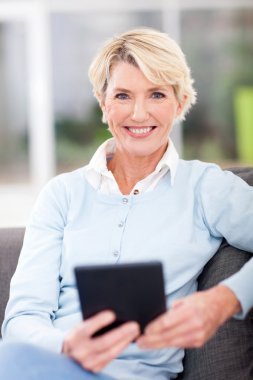 Modern senior woman with tablet computer