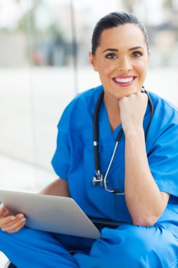 Happy medical doctor with laptop computer looking at the camera stock vector