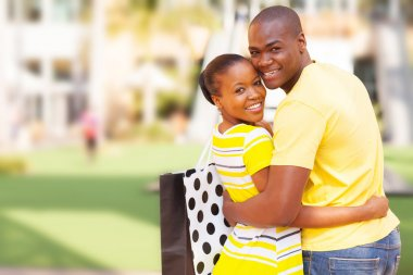 African american couple outside shopping mall