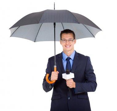 news journalist holding an umbrella