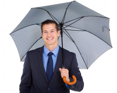 young business executive holding umbrella