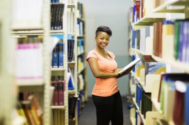 Girl standing near bookshelfs