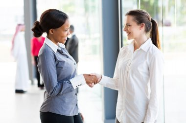 Businesswomen handshaking