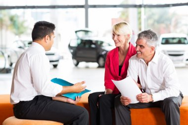 Salesman explaining contract to couple