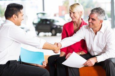 Salesman handshaking with buyer