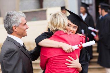 Graduate embracing her mother