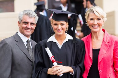 Female graduate with parents at graduation