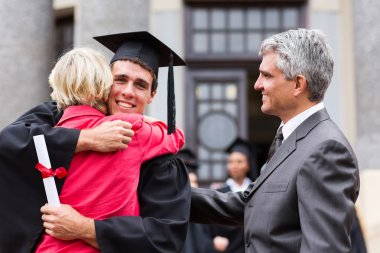 Graduate hugging his mother