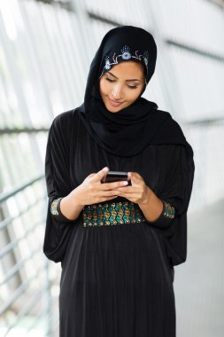 Muslim woman reading email
