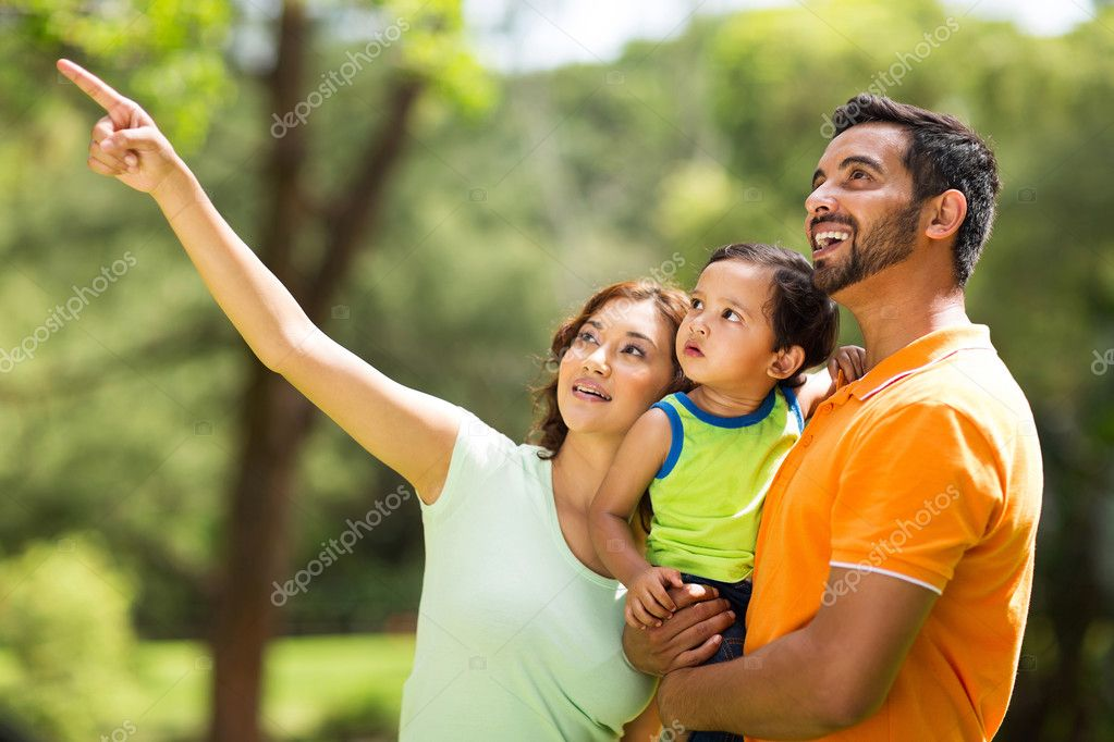 young indian family bird watching outdoors
