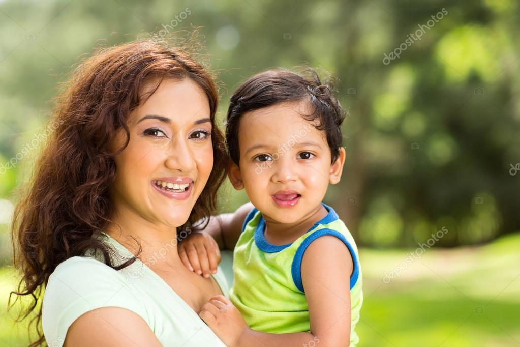 happy young indian mother and baby boy