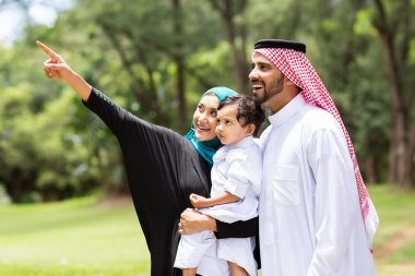 Arabian family in the forest
