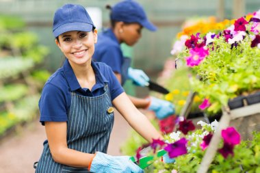female florist working in nursery