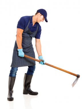 Gardener working with a hoe