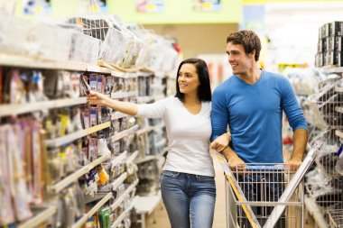 Couple buying padlock