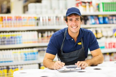 Hardware store worker making notes