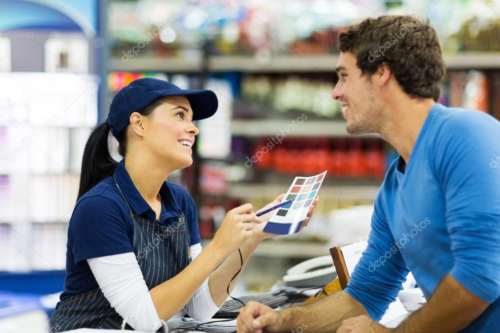 Store worker talking to customer
