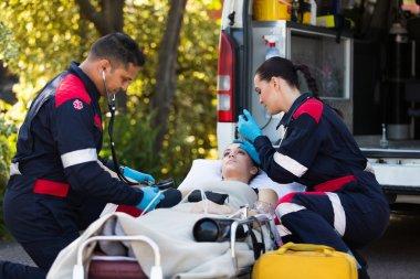 Paramedics rescuing patient