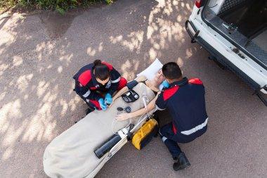 Paramedic team providing first aid